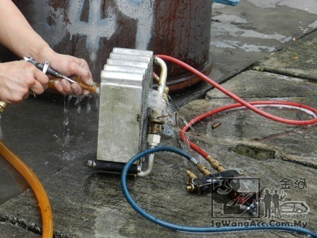 Spray the coil with water until it's clean